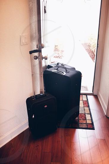 3 suitcase on the door photo