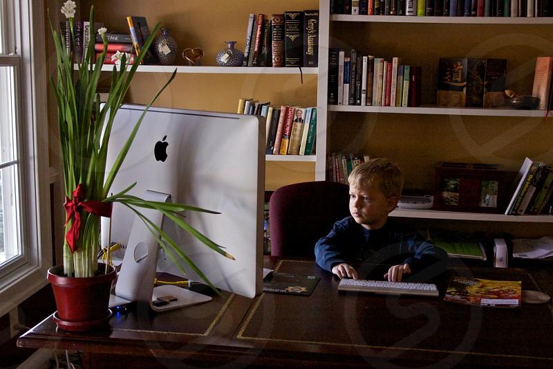 Boy at computer photo