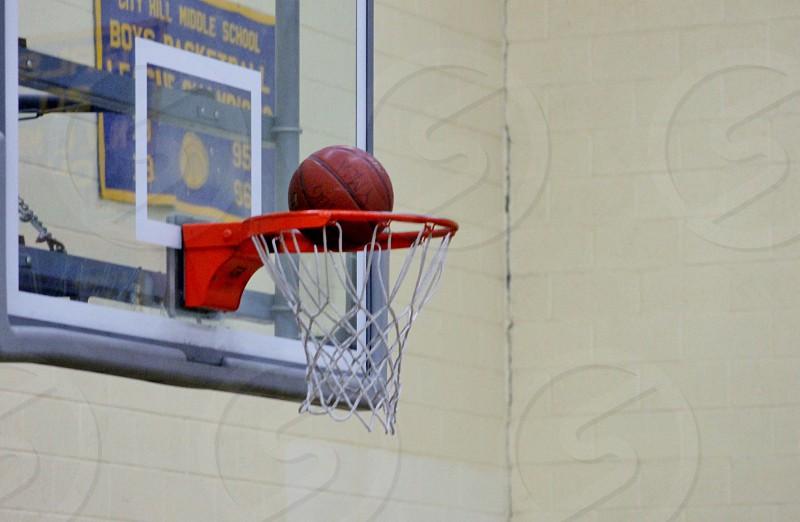 brown basketball in the hoop photo