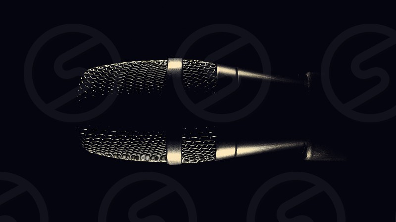 Black modern microphone on stand black dark background. Accentuated shapes with light.  photo