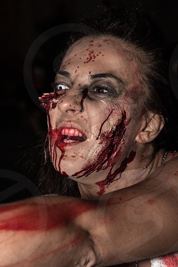 woman in zombie costume during night time photo