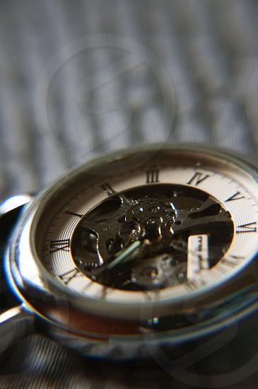 silver skeleton watch photo
