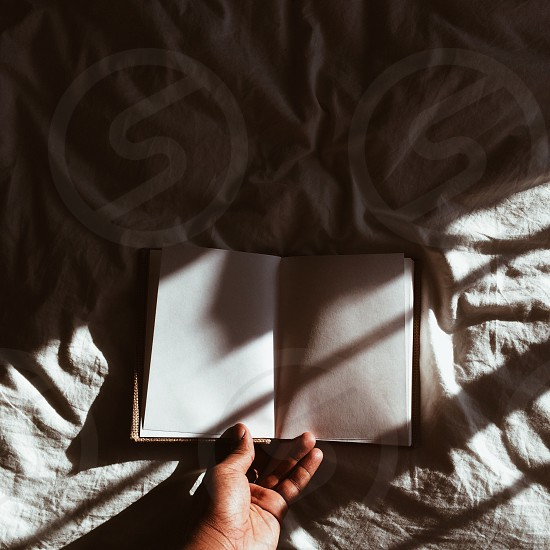book opened on a white textile photo