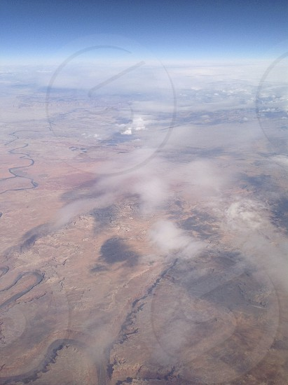 desert from plane with clouds photo