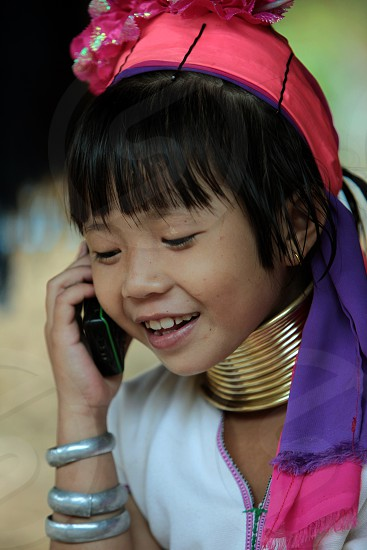a traditional Longneck women of the Paudang minority from Burma in a village  north of chiang mai in the north of Thailand in Southeastasia.  photo