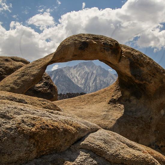 beige rock arch photo