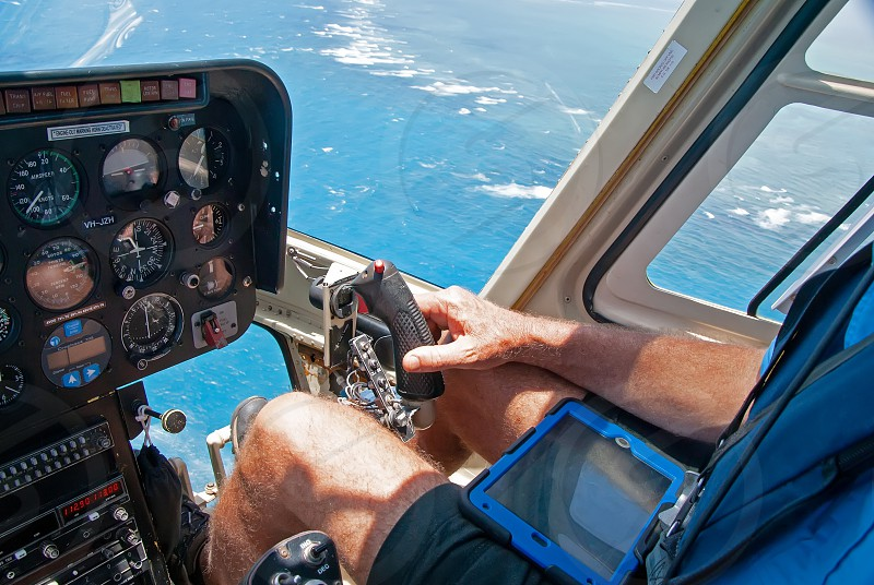 A pilot is flying helicopter photo