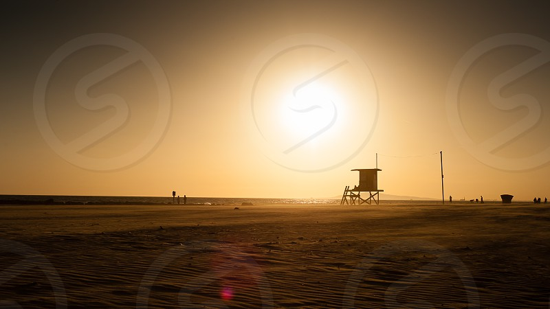 sunset lifeguard tower beach photo