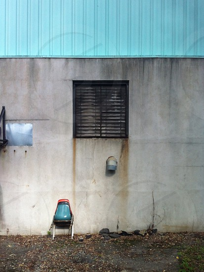 black window shutters on concrete wall photo