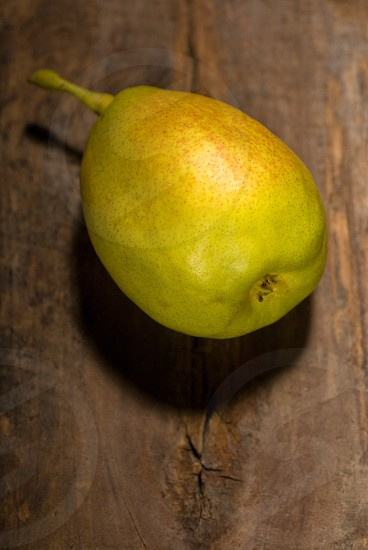 autumn fresh pear over old wood board photo