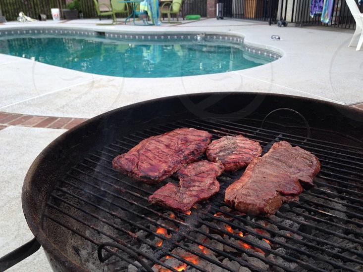 Pool side BBQ grass fed beef top sirloin steaks  photo