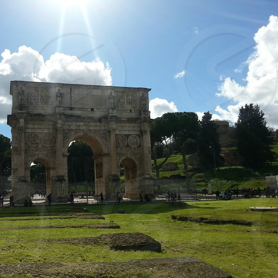 Arch of Constantine next to the Colosseum in Rome Italy in March 2016 photo
