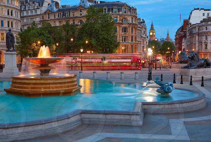 London Trafalgar Square fountain at sunset England photo