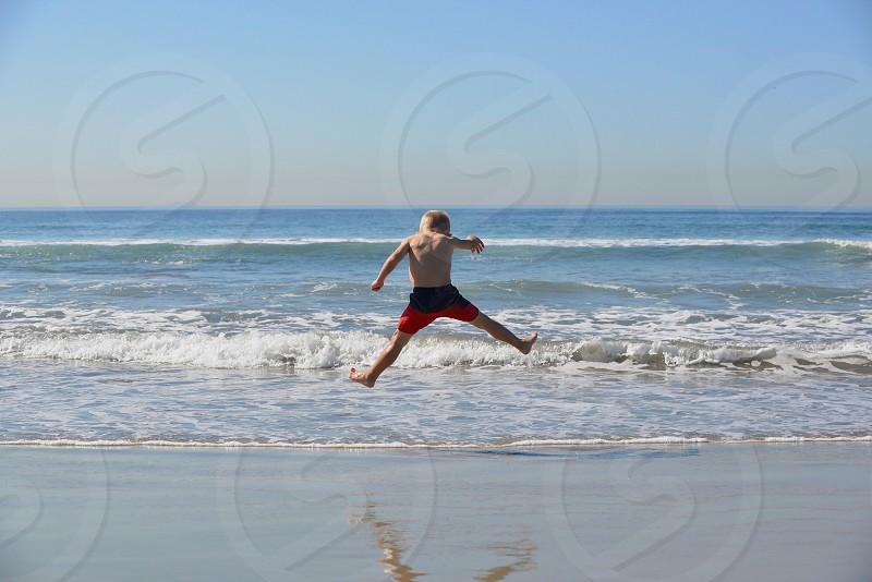 Beach jumpin... photo