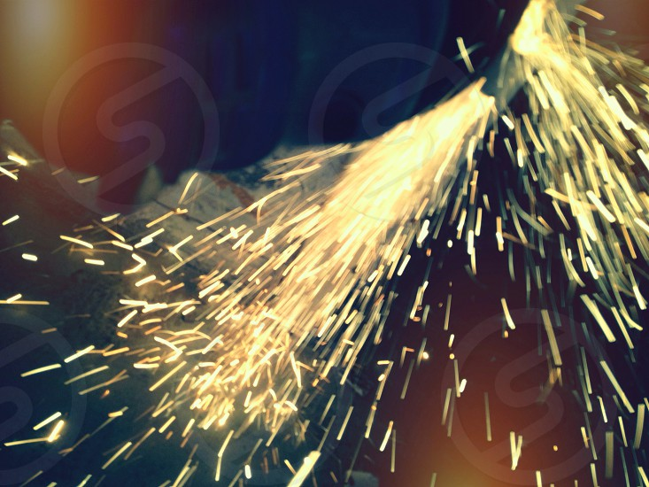 sparks flying grinding construction site power tools photo