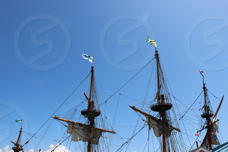 Detail view of the masts of a vintage tall ship photo