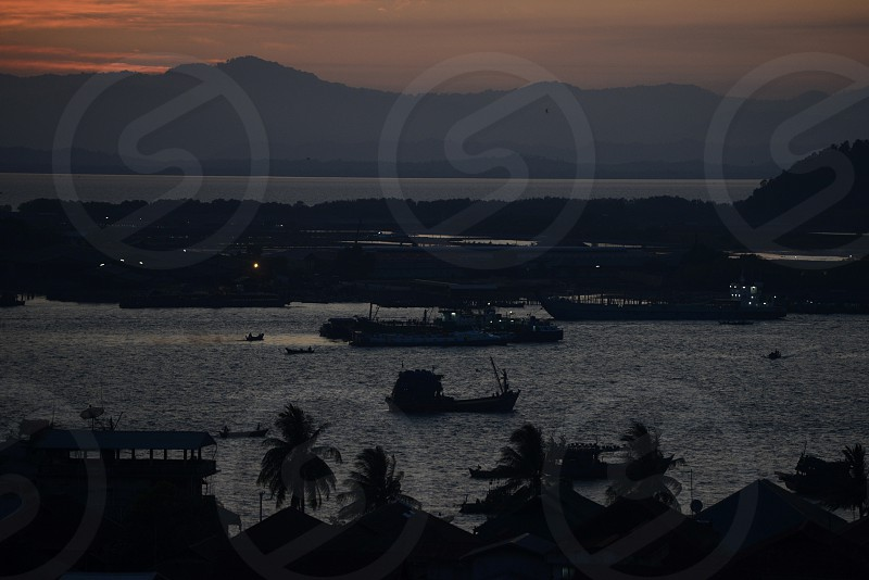 the sunset at the Harbour at the coast of the Andaman sea of Myeik in the south in Myanmar in Southeastasia. photo