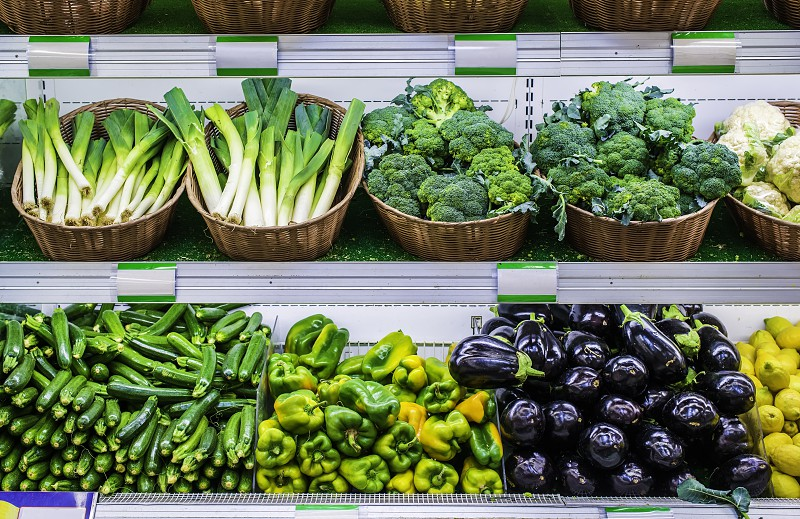 Fruits and vegetables on a supermarket shelf. photo