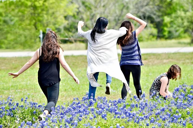 Park friends fun flowers field park blue bonnets  photo