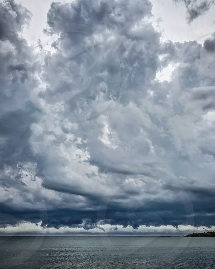 Large storm clouds over water photo