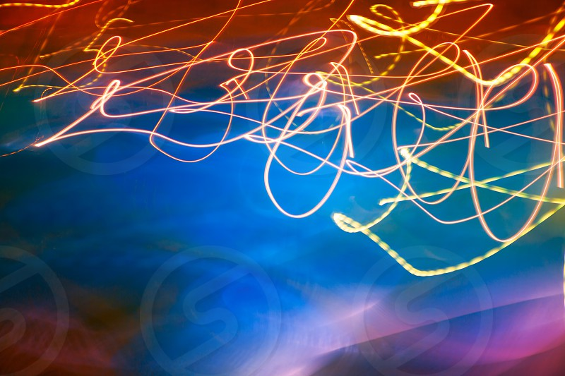 Abstract motion blurred lights on blue background photo