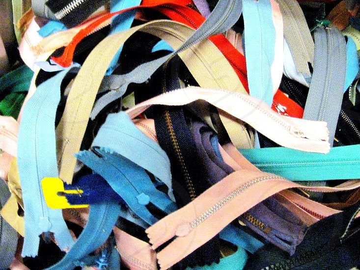zippers in a second hand store photo