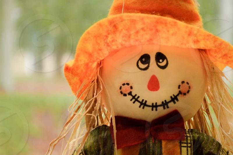 Scarecrow Halloween Orange Hat Bowtie Creepy Face.  photo