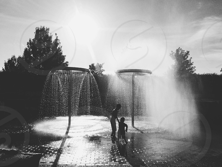 kids playing in water feature photo
