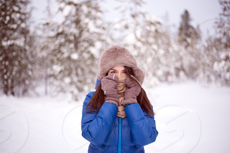 beautiful girl in a snowy park photo