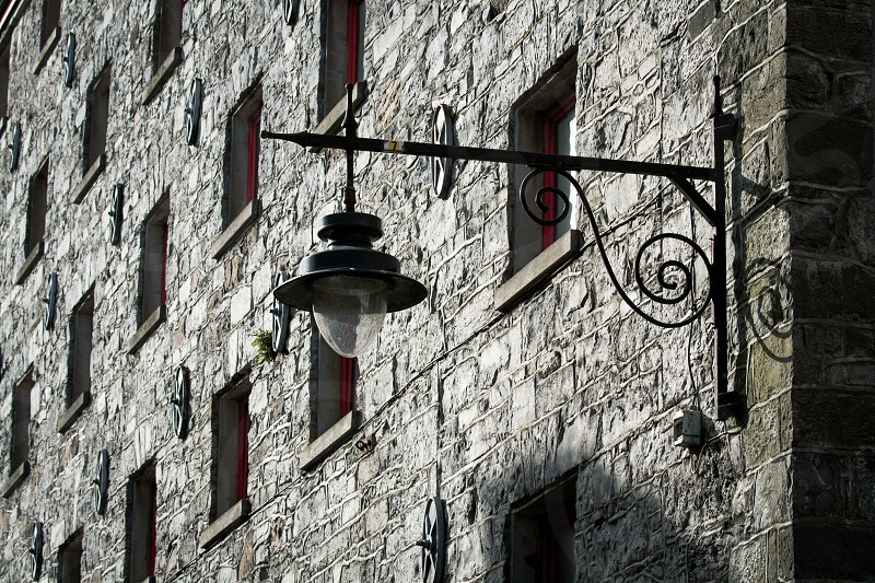 A lantern on an old stone building in Ireland photo