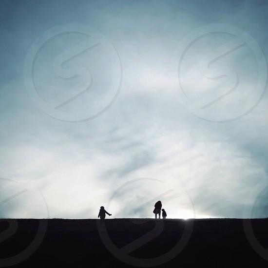 3 person silhouette photo
