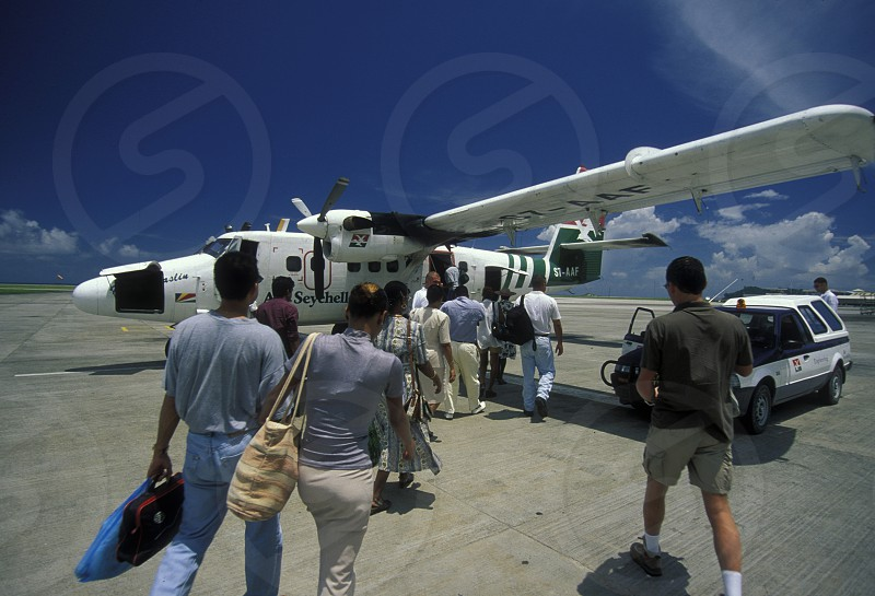 a airplane of the Air Seychelles on the Island Mahe of the seychelles islands in the indian ocean photo