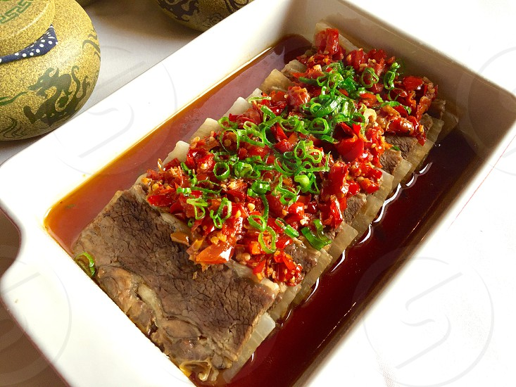 brown meat on white ceramic tray photo