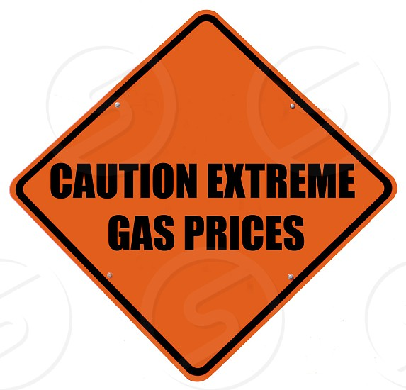 Caution extreme gas prices sign. Signage icon symbol warning photo
