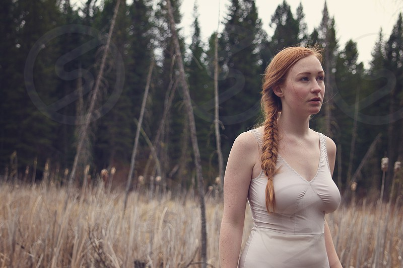 young woman field outdoor red hair storytelling romance searching longing love lost earthy natural photo