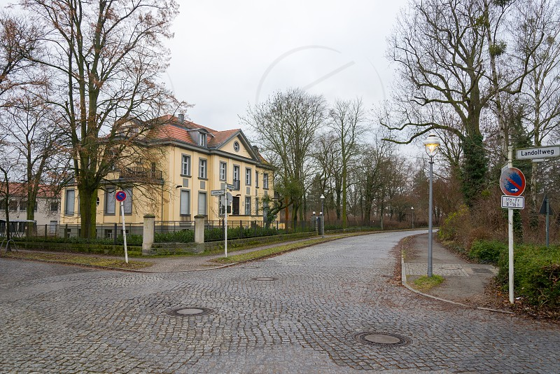 Street and  villas between Thielpark and Freie University  inside Dahlem Neighborhood in Berlin Germany The Thielpark is a center which nice villas is located around.  photo