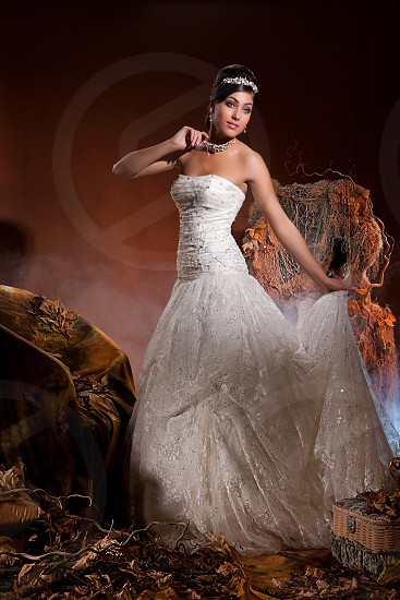 Young beautiful woman in a wedding dress photo