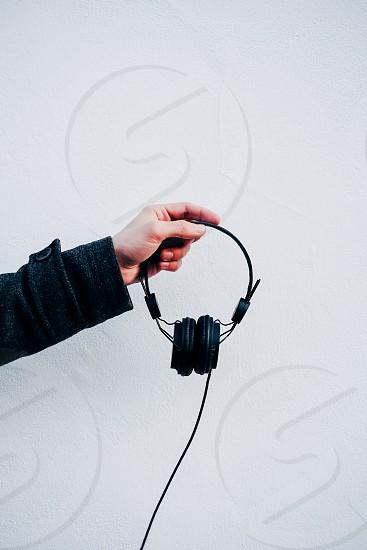 man holding headphones photo