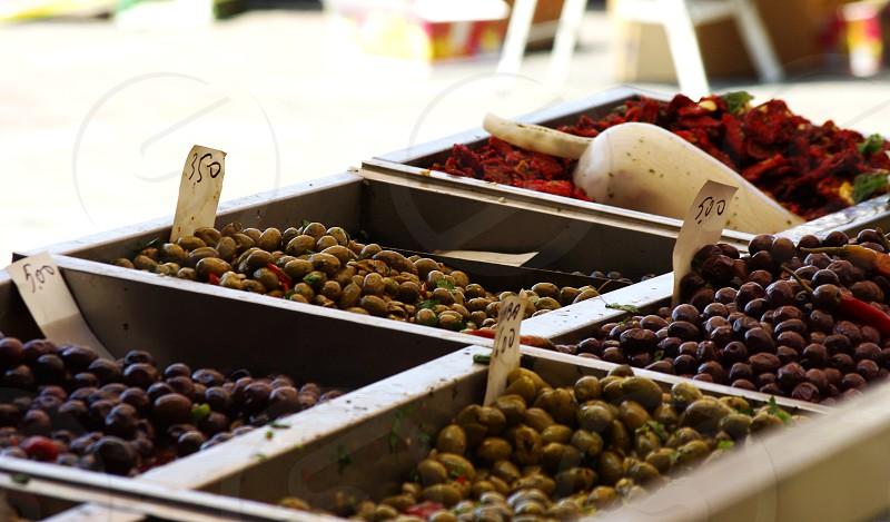 fresh olives farmer's market market stall Mediterranean green and black olives tasty fresh produce photo