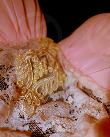 white lace cloth with pearl detail photo