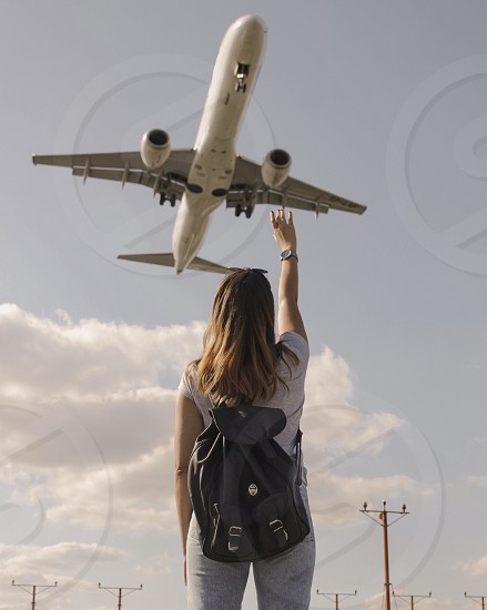 Girl travel traveling plane adventure in the sky flying solo traveling photo