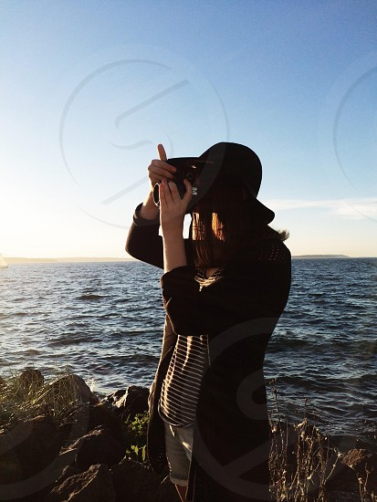 woman taking photograph of her surroundings photo