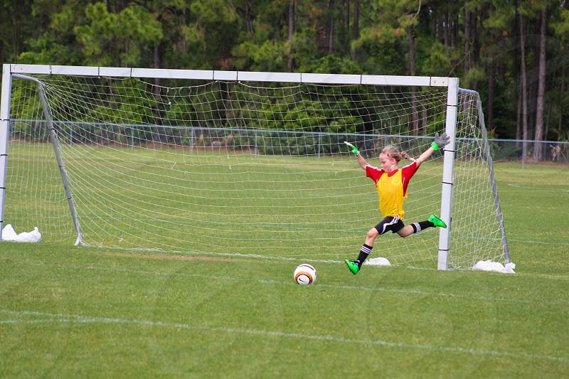 girl standing near soccer goalie net photo