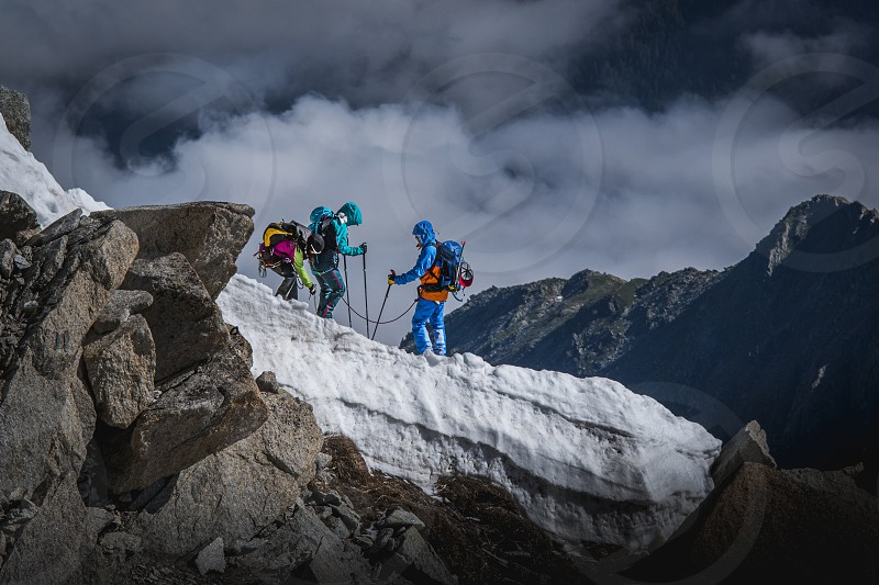 Mountaineers set off from the Aguille Du Midi in the French Alps. photo