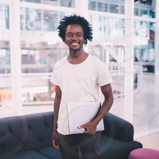 Portrait of young african businessman in the office photo