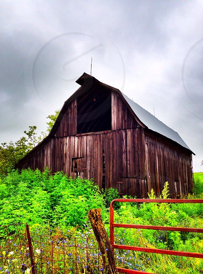 Barn fenceposts trees grass form farmland farmer tractors combine photo