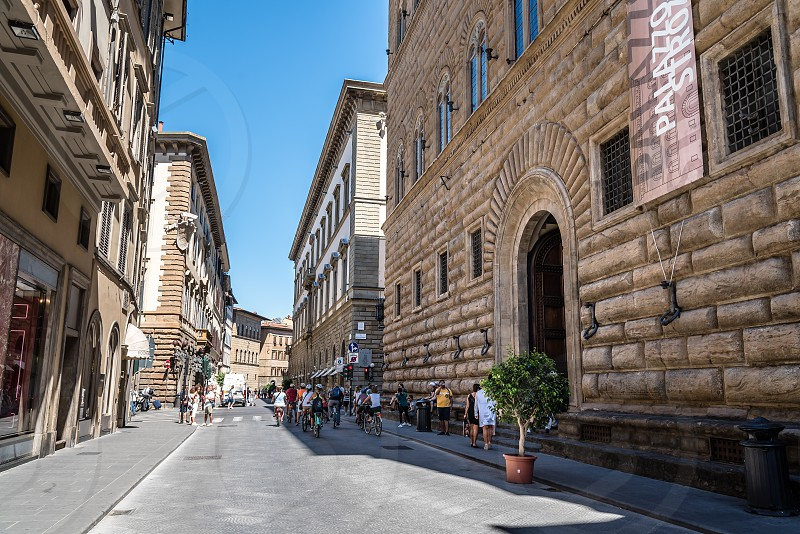 Palazzo Strozzi in Florence a sunny day of summer. It´s a renaissance palace and an example of civil architecture with its rusticated stone. photo