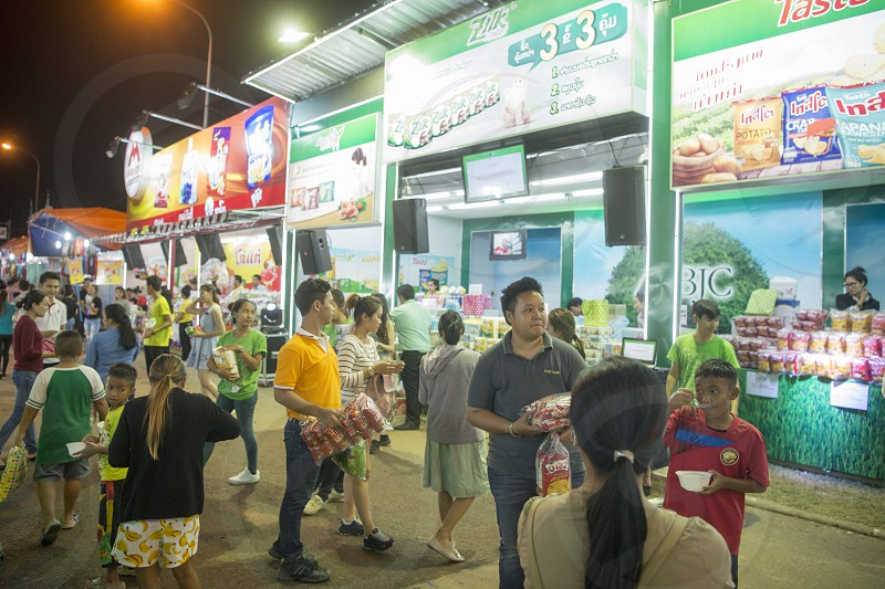 people at a trade fair shop at the market at the Pha That Luang Festival in the city of vientiane in Laos in the southeastasia. photo
