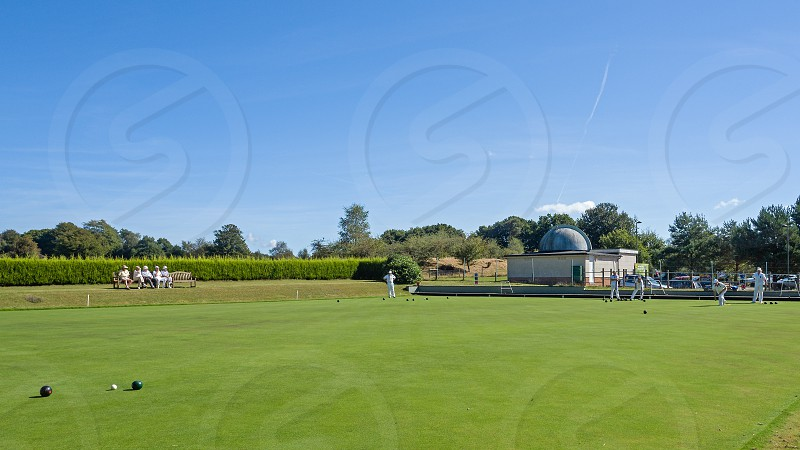 ISLE OF THORNS SUSSEX/UK - SEPTEMBER 11 : Lawn Bowls Match at Isle of Thorns Chelwood Gate in Sussex on September 11 2016. Unidentified people photo