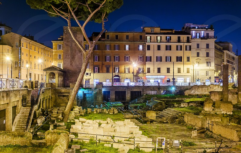 Night view of Largo di torre Argentina. Largo di Torre Argentina is a square in Rome Italy that hosts four Republican Roman temples and the remains of Pompey's Theatre. It is located in the ancient Campus Martius photo